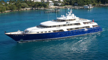 superyacht leaving tropical islands with yacht engineers