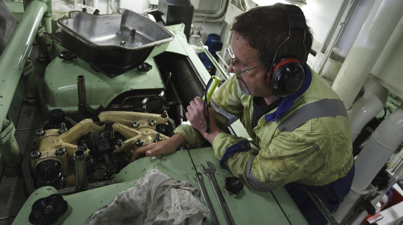 yacht engineer working on engine repairs
